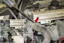 Working at the radiator hose, use a flathead screwdriver to loosen the hose clamp (red arrow).