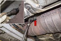 Replacing sensors after catalytic converter: Using an oxygen sensor socket (red arrow), remove the oxygen sensor connection to the catalytic converter (inset).