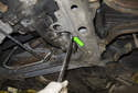 Place a drain pan under the transmission and loosen the 24mm fluid drain plug (green arrow).