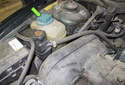 Coolant will be filled and the level is checked at the coolant expansion tank also referred to as the reservoir.