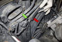 Working at the left side of the cooling fan shroud, locate the vacuum solenoid (green arrow).