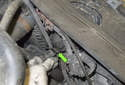 High beam bulb: Working at the inner edge of the headlight assembly, lift the tab (green arrow) up and remove the plastic cover from the headlight.