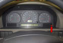 The service indicator is illuminated in the instrument cluster (red arrow) every 7500 miles.