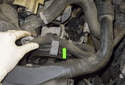 Remove the power steering hose from the mount at the pump (green arrow).