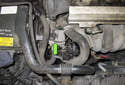 The power steering pump on V70 models is mounted to the right side of the engine (green arrow).