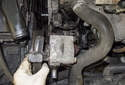 With the fasteners removed, pull the power steering pump away from the mounting bracket.