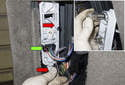 Remove the electrical connector by pulling it straight out of the bulb holder (green arrow).