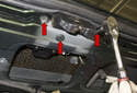 Remove the three T40 Torx tail gate latch fasteners (red arrows).