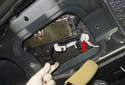Then, pull the latch out just enough to access the lock rod (red arrow).