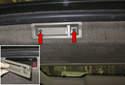 Remove the tailgate interior side trim panels.