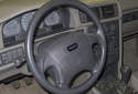 The Volvo V70 steering wheel and steering column house a number of electrical and electronic controls.