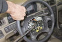 While loosening, hold the steering wheel still and slowly break the bolt free.