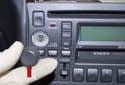 Pull the volume knob straight off the radio (red arrow).