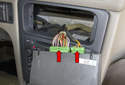 Pull the climate control panel away from the instrument panel enough to access the electrical connectors.