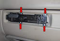 Handle Assembly: Using a T10 Torx driver, remove the four handle assembly fasteners (red arrows).