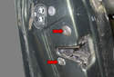 This photo shows the door latch fasteners loosened six turns (red arrows).