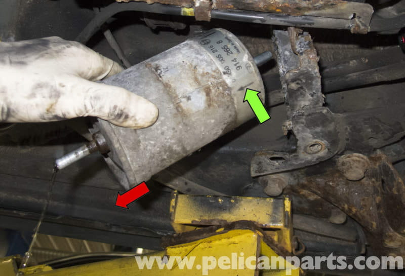 slide the fuel filter out of the clamp to remove it