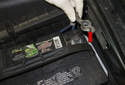 Disconnect the negative (-) battery cable (red arrow).