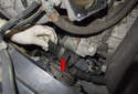 Start by removing the starter insulation shield (red arrow).