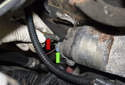 Working at the back of the starter solenoid, pull the small wire (red arrow) straight off to remove it.