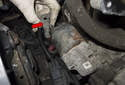 Next, pull the starter cables off the starter solenoid (red arrow).