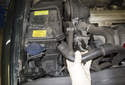 Working at the right side of the engine compartment, pull the E-box cooling vent hose off and place it out of the way.