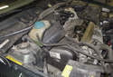 Place the coolant and power steering reservoirs on the engine out of your way.