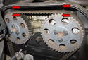 Reinstall the plastic engine cover over the camshaft sprockets.