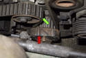 Check that the tab (red arrow) on the crankshaft gear is aligned with the mark on the timing cover.