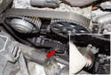 Once the marks are aligned and the engine is at TDC, remove the timing belt tensioner 13mm fastener (red arrow).