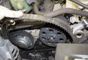 Once the tensioner is removed, remove the timing belt from the engine.
