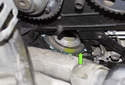 If you're replacing the water pump, remove the old gasket (green arrow) and clean the engine crankcase to water pump sealing surface.