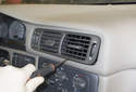 Working at the center of the dashboard, remove the air vents.