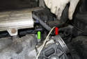 When removing the duct, detach the vent hose (red arrow) from the injector rail (green arrow).