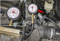 Pressure testing: Connect a fuel pressure test gauge to the test port (red arrow).