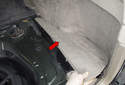 Electrical testing: Pull the side trim panel (red arrow) up to remove it.