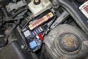 Electrical testing: Remove the under hood fuse panel cover.
