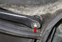 Next, remove the two 13mm wiper arm nuts (red arrow).