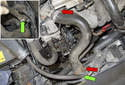 Remove the coolant reservoir vent hose from the radiator (green arrows).