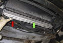 To the remove radiator, pull it down and out of the radiator support (green arrow).