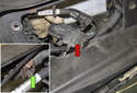 Remove the wiper motor from the radiator support (red arrow).