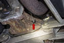 Pump oil into the fill plug hole (red arrow) until it runs out.