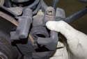 Pull the brake caliper off the brake rotor and caliper bracket.