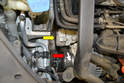 You will need to remove the ribbed belt (yellow arrow) and tensioner (red arrow).