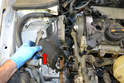 Remove the lower timing belt cover (red arrow).